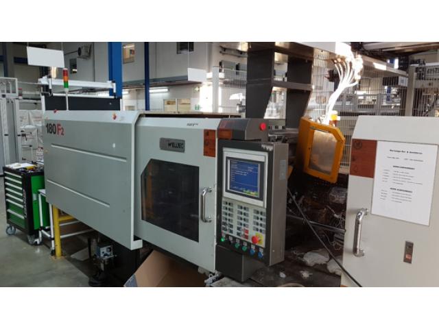 Spritzgießmaschine mit Robotsystem Welltec 180 F2 - 1